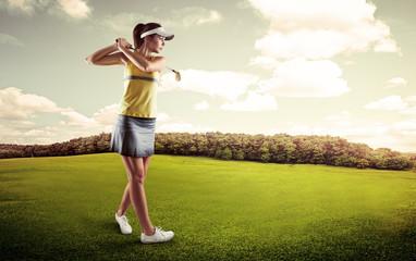 Active female player preparing for hitting golf ball.