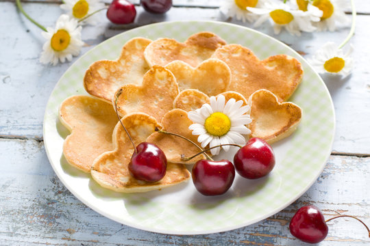 Heart shaped pancakes with cherry