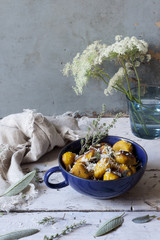 pumpkin dumplings on cup with sage on table with flowers