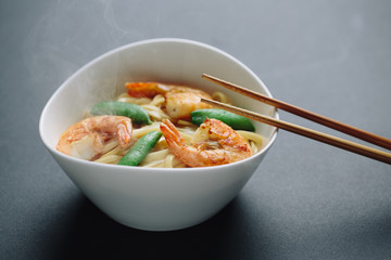 hot noodles with shrimps on a black background
