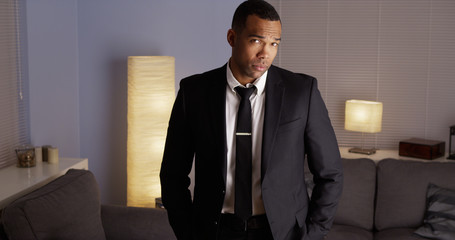 Attractive black man standing and looking at camera