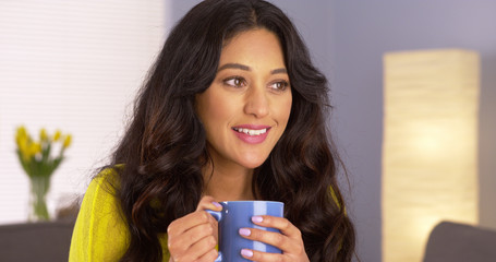 Mexican woman enjoying her cup of coffee