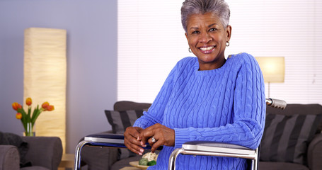 Happy Mature black woman sitting in wheelchair