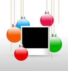 Blank photoframe with christmas multicolored balls on grayscale