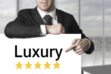 businessman pointing on sign luxury golden stars
