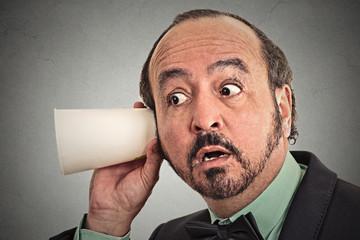 Headshot curious businessman listening to conversation