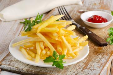 fries on  wooden board