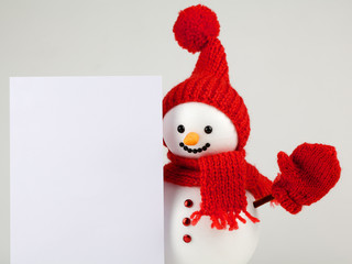 Snowman with white paper for text