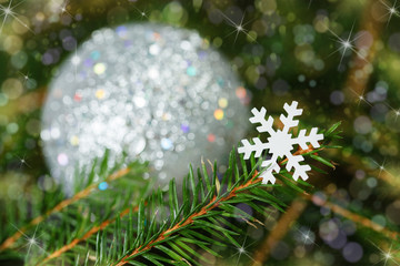 snowflake on a fir-tree branch. Christmas card.