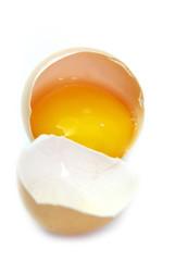 Broken egg on white