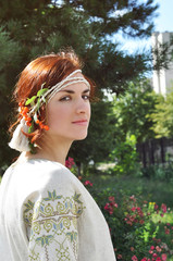 Beautiful Ukrainian girl on the garden