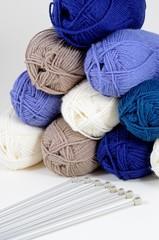 Balls of wool and knitting needles © Arena Photo UK