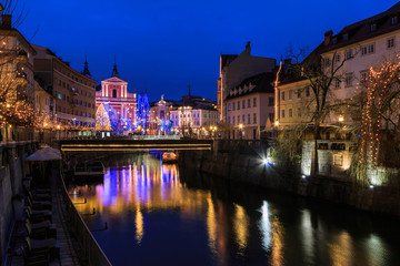 View of Ljubljanica river in old center decorated for Christmas