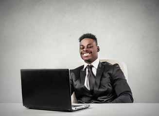 Happy businessman working at pc
