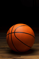 Basket ball sitting on wood floor