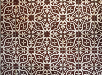 Tiled floor with brown Mediterranean decorations