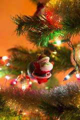 Beautiful Santa Claus with lights on Christmas Tree