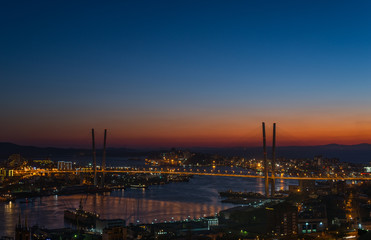 Vladivostok cityscape, sunset with a few stars in the sky.