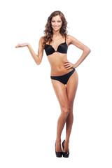 Gorgeous woman in black bikini holding something imaginery