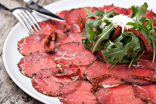 white dish with carpaccio of beef