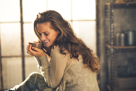 Portrait of relaxed young woman with cup of coffee