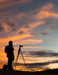 photographer silhouette golden sunset