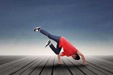 Energic man dancing outdoor