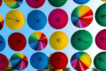 colorful umbrellas disclosed rows on sky background