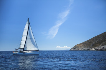 Sailboat in the calm sea. Sailing. Luxury yachts.