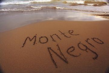 beach sand summer inscription on the sand