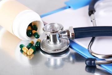 Stethoscope, pills and bottles