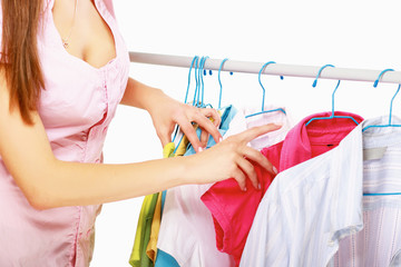 Beautiful woman shopping for some clothes at a store isolated on