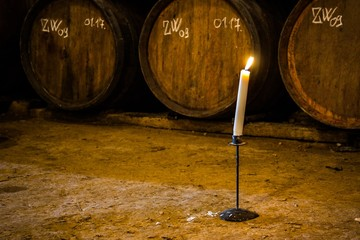 Fototapete - Candle in wine cellar