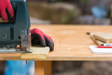 Carpenter sawing a board