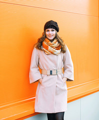 Outdoor fashion portrait pretty stylish woman in coat against co