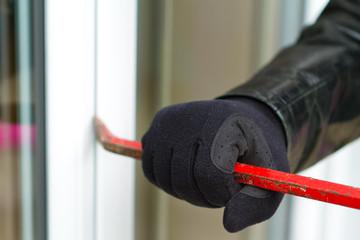 Burglar breaking in a house - fototapety na wymiar