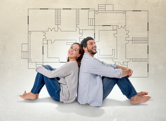 Young couple imaging new house blueprints in real state concept