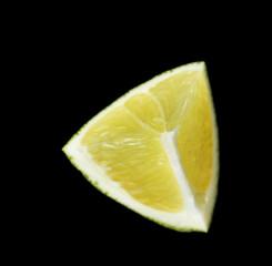 Lime slice on black background
