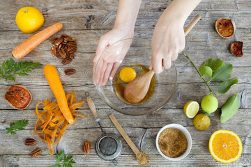 hands working on wooden table with raw ingredients