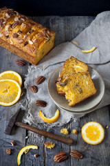 two slices of citrus cake with hammer and orange slices