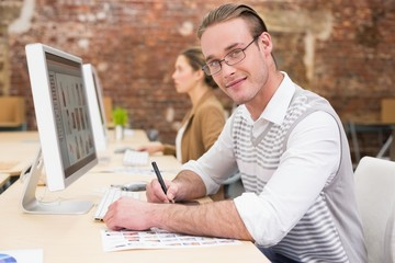 Male photo editor using digitizer in office
