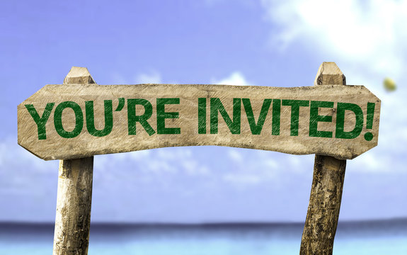 You're Invited! wooden sign with a beach on background