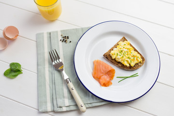 Top view of high protein breakfast with eggs and salmon