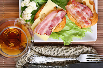 Serving breakfast toast with bacon and herbs