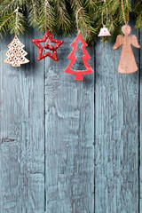 Vintage christmas decorations on old wooden background