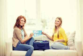 two smiling teenage girls with plane tickets