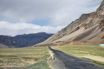Scenic road in high mountain valley