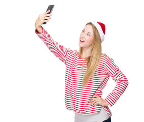 Woman with xmas hat and take selfie