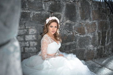 Beautiful bride outdoors. Castle. Wedding day.