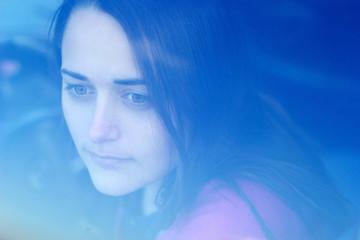 portrait girl woman outside the window of blue background